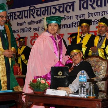 President Bidya Devi Bhandari confers the honorary PhD degree on writer Jhamak Kumari Ghimire, who is struggling with cerebral palsy, at a special convocation ceremony of Mid-Western University, in Kathmandu, on Monday, September 5, 2016.
